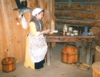 Woman at table in Fort Delaware