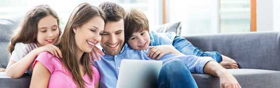 Family of four look at computer screen