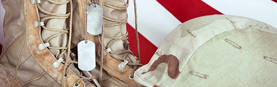 Dog tags hanging on boot with helmet